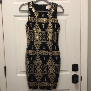 Black & gold cocktail dress.